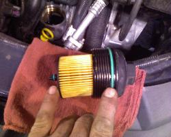 Torn O ring on the oil filter pictures in the GM 2.2L Ecotec engine in many Chevy, Buick, and Pontiac cars.