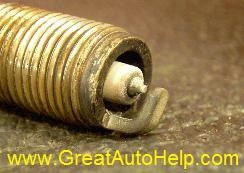 Inspecting spark plugs. Discoloration means different things.