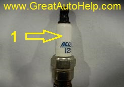 Cracked spark plug will cause misfire and an engine that idles rough.