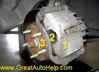 Typical GM front wheel drive brake caliper, pads and rotor still installed.