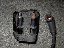 Corroded ignition coil and spark plug wire causing engine misfire and check engine light.