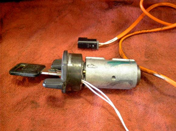Passkey security ignition cylinder removed showing where common broken wires are.