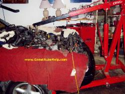 Removing Ford Mustang engine with crane or cherry picker.
